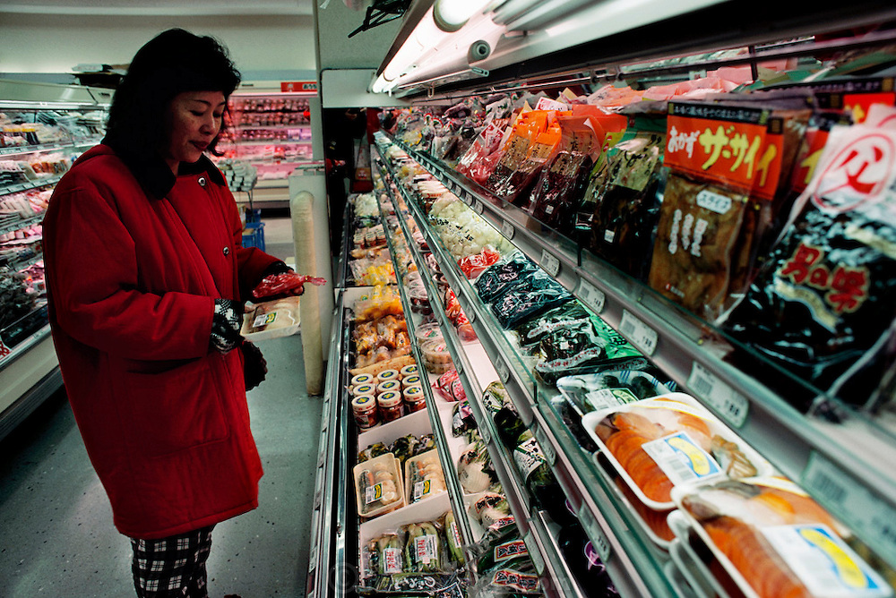 Sayo Ukita shops for food and sundries in her Kodaira City neighborhood. Japan. Material World Project. The Ukita family lives in a 1421 square foot wooden frame house in a suburb northwest of Tokyo called Kodaira City.