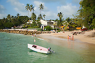 """Barbados' West Coast, which faces the Caribbean, is host to most typical beach holiday travelers with it's calm water, sandy beaches and high-end hotels and villas.  It's known as the """"Gold"""" or """"Platinum"""" Coast as most of the accommodations cater to the very wealthy.  Nonetheless, all the beaches in Barbados are open to the public, there are no private beaches on the island.  The beach at Cobbler's Cove, adjacent to the hotel of the same name."""