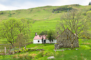Quaint cottage dwelling and old stone barn at Auchindrain highland farming township settlement and village folklore museum at Furnace near  Inveraray in the Highlands of Scotland
