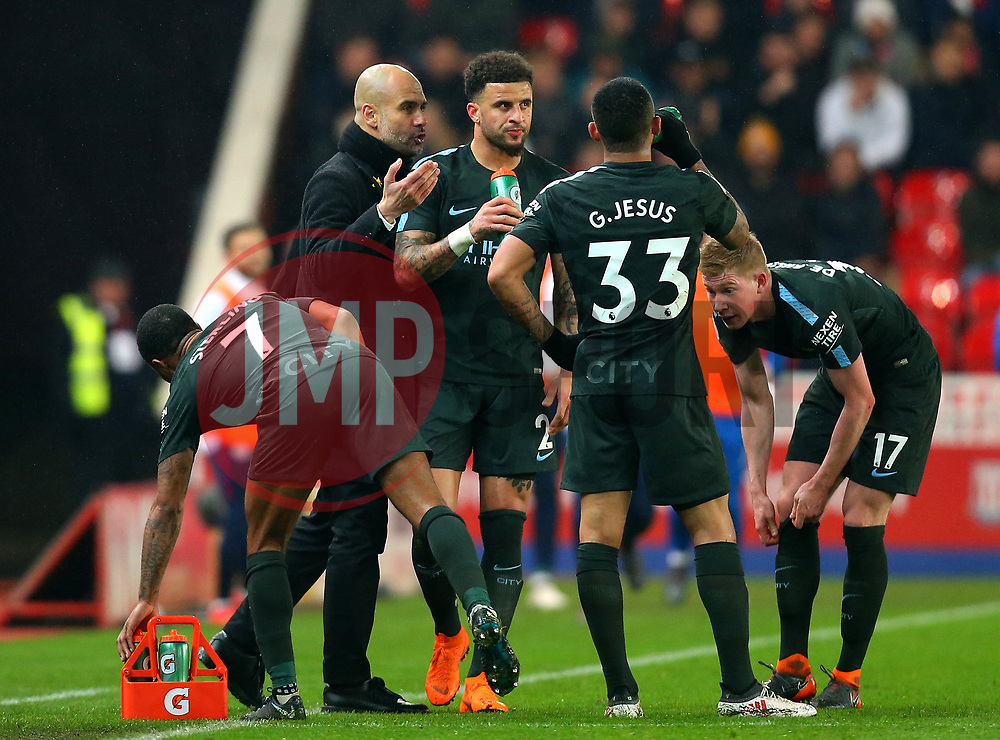 Manchester City manager Pep Guardiola speaks to his players - Mandatory by-line: Robbie Stephenson/JMP - 12/03/2018 - FOOTBALL - Bet365 Stadium - Stoke-on-Trent, England - Stoke City v Manchester City - Premier League