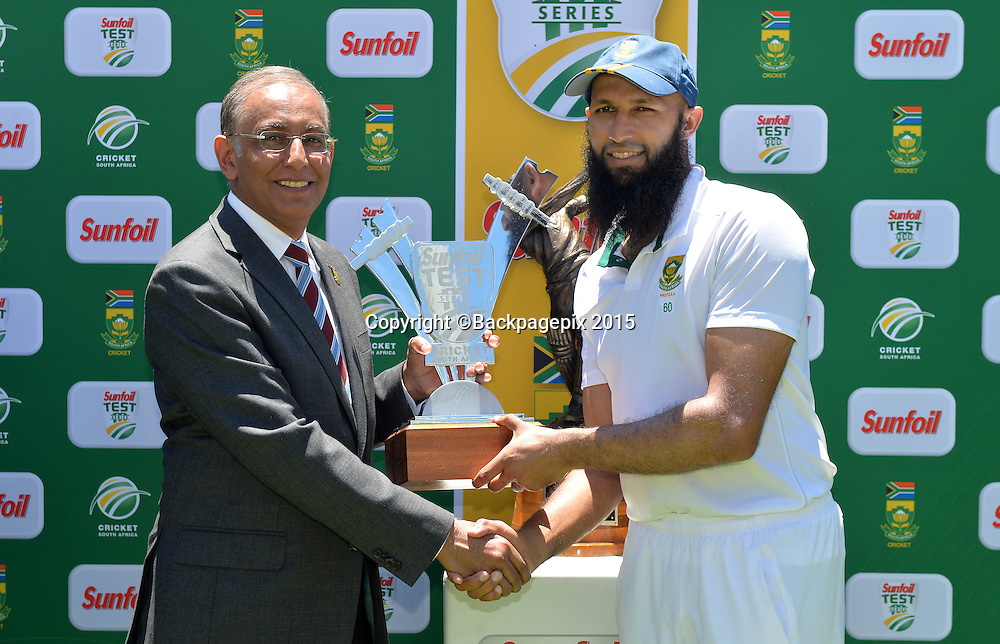 Hashim Amla of South Africa, receives the winning trophy during Day 5 of the 2015 Sunfoil Test Series Cricket Match between South Africa and the West Indies at Newlands Stadium, Cape Town on 5 January 2015 ©Chris Ricco/BackpagePix