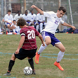 Radnor's James Cellucci (20) and Upper Darby's Ian Matherson (21) fight for a loose ball in the first half during the Radnor at Upper Darby boys soccer game in Upper Darby Tuesday September 9, 2014. (Times staff / TOM KELLY IV)