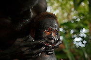 Young boy having make up put on for the snake dance. Rah Lava Island, Torba Province, Vanuatu