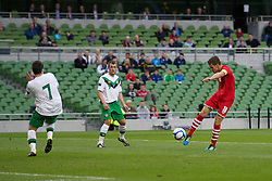 DUBLIN, REPUBLIC OF IRELAND - Friday, May 27, 2011: Wales' captain Aaron Ramsey scores the first goal against Northern Ireland during the Carling Nations Cup match at the Aviva Stadium (Lansdowne Road). (Photo by David Rawcliffe/Propaganda)