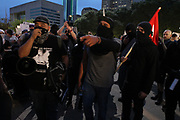 Members of the anarchist group Intifa converge at Dallas City Hall to protest against white supremacist groups on Saturday August 19, 2017.