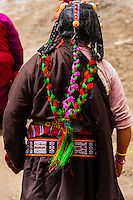 Tibetan woman with braided hair, Tibet (Xizang), China.