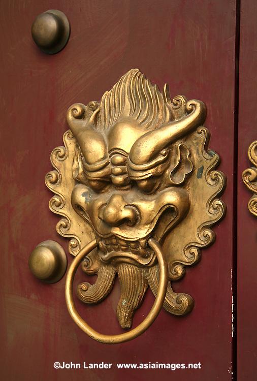 Chinese Lion Doorknob, Macau | John Lander Photography