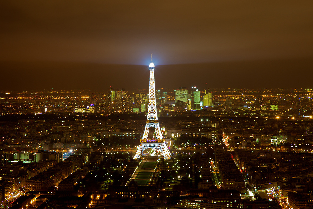 A classic night view of the Tour Eiffelle from Mount Parnasse Tower in Paris.<br />