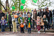 The crowd waves and waits for candy during the homecoming parade on Oct. 11, 2014.