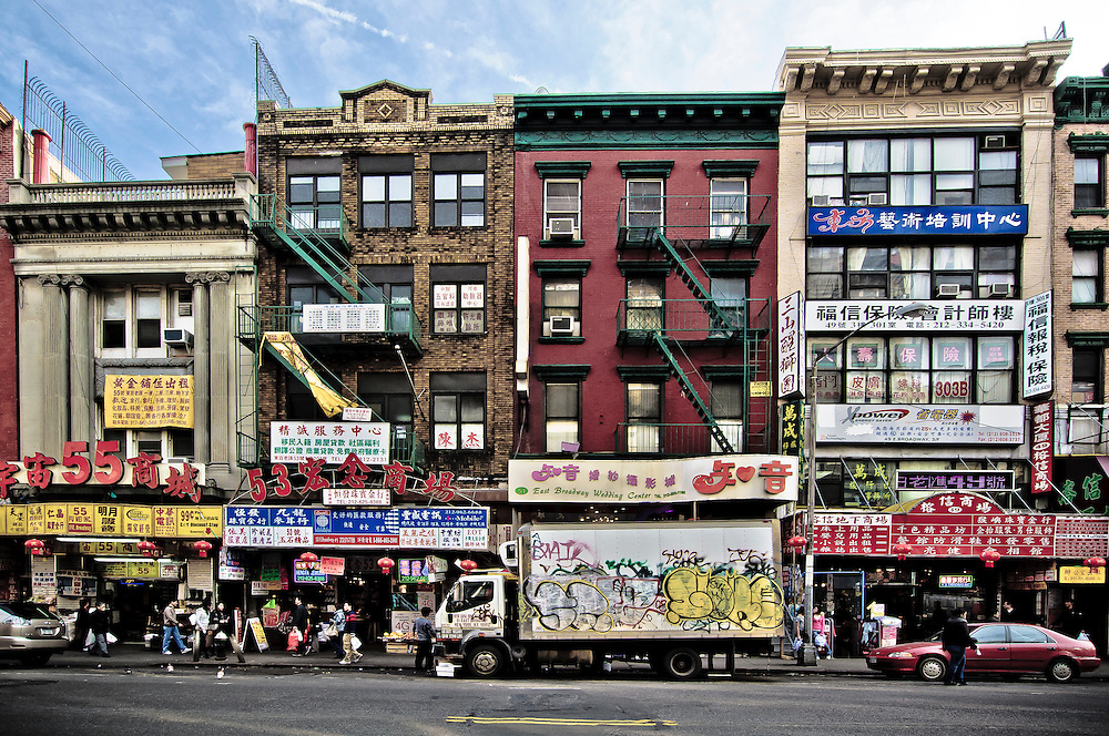 Photo of the stores and buildings on East Broadway street in Chinatown, Manhattan, New yORK