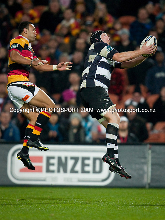 Sosene Anesi and Thomas Waldrom go high for the ball during the Air New Zealand Cup rugby match between Waikato and Hawkes Bay won by Waikato 30-22 at Waikato Stadium, Hamilton, New Zealand, Saturday 05 September 2009. Photo: Stephen Barker/PHOTOSPORT
