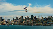 The Navy Blue Angels fly over the San Francisco city skyline during Fleet Week 2012. Photo by John Lill.