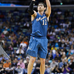February 1, 2011; New Orleans, LA, USA; Washington Wizards guard Kirk Hinrich (12) shoots over New Orleans Hornets during the third quarter at the New Orleans Arena. The Hornets defeated the Wizards 97-89.  Mandatory Credit: Derick E. Hingle