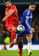 Eden Hazard of Chelsea (right) and Emre Can of Liverpool (left) during the Capital One Cup Semi Final 2nd Leg match between Chelsea and Liverpool at Stamford Bridge, London, England on 27 January 2015. Photo by David Horn.