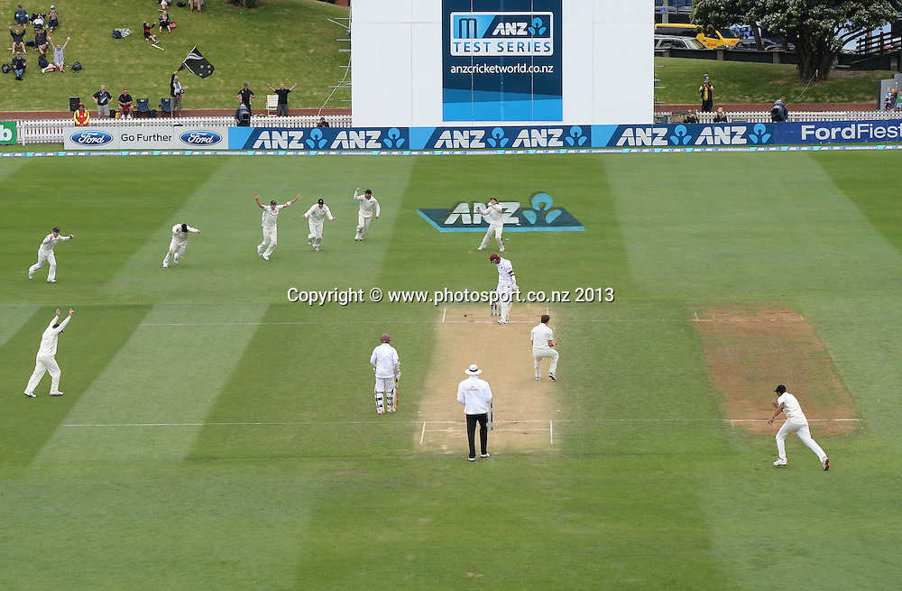 Trent Boult takes the wicket of Shannon Gabriel to rap up a famous win on Day 3 of the 2nd cricket test match of the ANZ Test Series. New Zealand Black Caps v West Indies at The Basin Reserve in Wellington. Friday 13 December 2013. Mandatory Photo Credit: Andrew Cornaga www.Photosport.co.nz