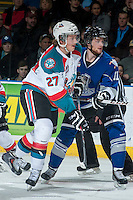 KELOWNA, CANADA -FEBRUARY 8: Steven Hodges #11 of the Victoria Royals is checked by Ryan Olsen #27 of the Kelowna Rockets during the second period on February 8, 2014 at Prospera Place in Kelowna, British Columbia, Canada.   (Photo by Marissa Baecker/Getty Images)  *** Local Caption *** Steven Hodges; Ryan Olsen;