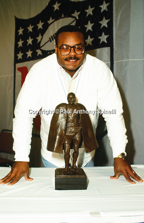 Chicago Bears linebacker Mike Singletary (50) smiles as he poses with the Man of the Year Award during the week of the NFL Super Bowl XXV football game between the Buffalo Bills and New York Giants on Jan. 27, 1991 in Tampa, Fla. The Giants won the game 20-19. (©Paul Anthony Spinelli)