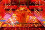A section of the Chrysler Building's huge mural shows the strong, bare back of a worker set in a background of almost Persian intricacy.<br />
