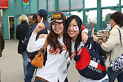 LOS ANGELES, CA - MARCH 22: Fans of Japan wear face stickers and point number one as they cheer for their team prior to the game against USA in game two of the semifinal round of the 2009 World Baseball Classic at Dodger Stadium in Los Angeles, California on Sunday March 22, 2009. Japan defeated USA 9-4. (Photo by Paul Spinelli/WBCI/MLB Photos)