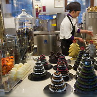 "VENICE, ITALY - DECEMBER 08:  A Chocolate maker at ""Vizio Virtu'"" prepares Chocolate Christmas Tree on December 8, 2011 in Venice, Italy. HOW TO LICENCE THIS PICTURE: please contact us via e-mail at sales@xianpix.com or call our offices in London   +44 (0)207 1939846 for prices and terms of copyright. First Use Only ,Editorial Use Only, All repros payable, No Archiving.© MARCO SECCHI"