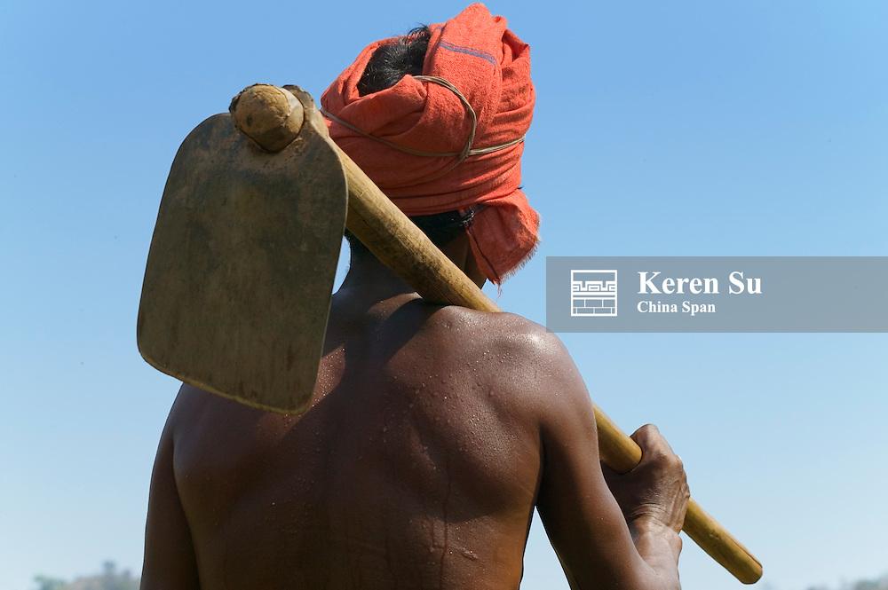 Man carrying a hoe, Orissa, India