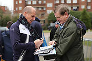 AFC Wimbledon assistant coach Neil Cox arriving and signing autographs during the EFL Sky Bet League 1 match between AFC Wimbledon and Southend United at the Cherry Red Records Stadium, Kingston, England on 1 January 2018. Photo by Matthew Redman.