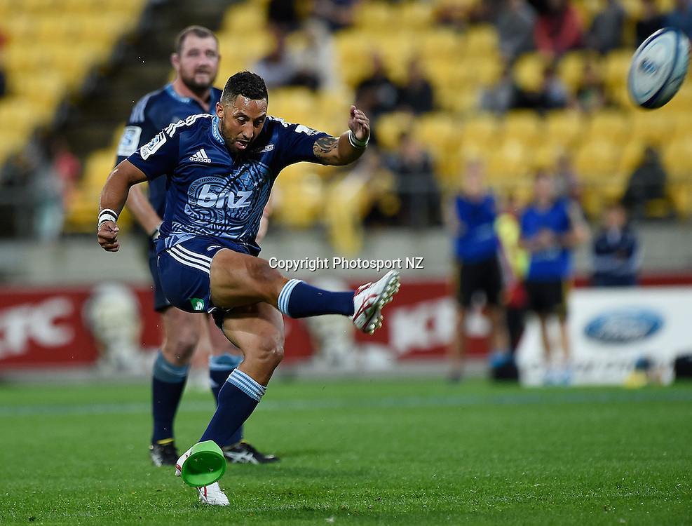 Benji Marshall of the Blues kicks a penalty during the Super Rugby - Hurricanes v Blues match at the Westpac Stadium in Wellington on Friday the 18th of April 2014.  Photo by Marty Melville/Photosport.co.nz