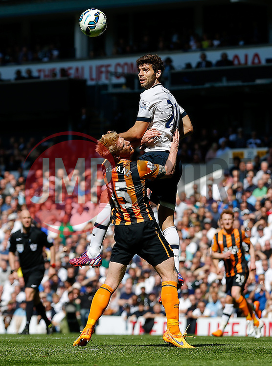 Federico Fazio of Tottenham Hotspur and Paul McShane of Hull City compete in the air - Photo mandatory by-line: Rogan Thomson/JMP - 07966 386802 - 16/05/2015 - SPORT - FOOTBALL - London, England - White Hart Lane - Tottenham Hotspur v Hull City - Barclays Premier League.