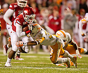Nov 12, 2011; Fayetteville, AR, USA; Arkansas Razorback running back De'Anthony Curtis (23) gets past Tennessee Volunteers defensive back Brian Randolph (37) to score a touchdown during the second half at Donald W. Reynolds Razorback Stadium. Arkansas defeated Tennessee 49-7. Mandatory Credit: Beth Hall-US PRESSWIRE