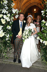 ORLANDO FRASER and CLEMENTINE HAMBRO at the wedding of Clementine Hambro to Orlando Fraser at St.Margarets Westminster Abbey, London on 3rd November 2006.<br />