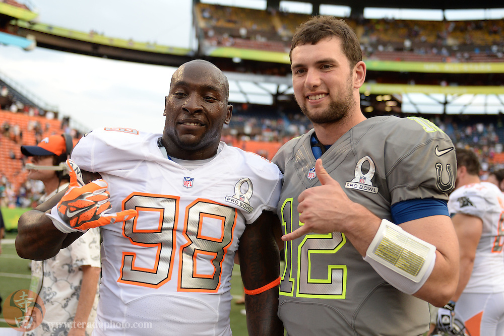 January 26, 2014; Honolulu, HI, USA; Team Rice linebacker Robert Mathis of the Indianapolis Colts (98) poses for a photo with Team Sanders quarterback Andrew Luck of the Indianapolis Colts (12) after the 2014 Pro Bowl at Aloha Stadium. Team Rice defeated Team Sanders 22-21.