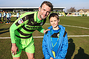 Forest Green Rovers Christian Doidge(9) with matchday mascot during the EFL Sky Bet League 2 match between Forest Green Rovers and Crawley Town at the New Lawn, Forest Green, United Kingdom on 24 February 2018. Picture by Shane Healey.
