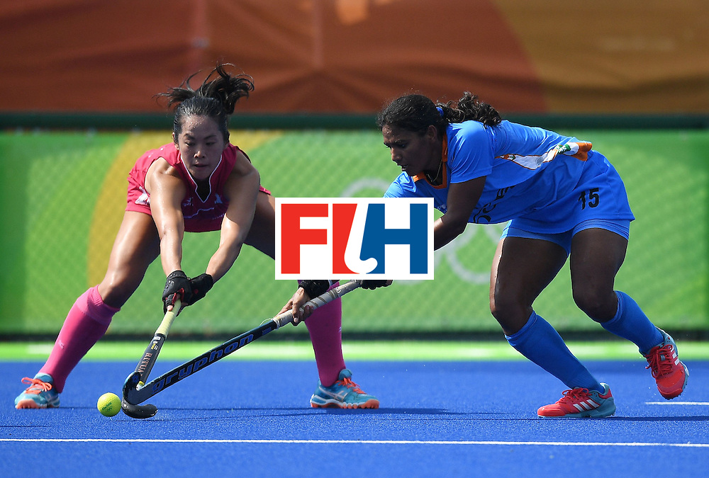 India's Poonam Rani (R) and Japan's Mie Nakashima fight for the ball during the women's field hockey Japan vs India match of the Rio 2016 Olympics Games at the Olympic Hockey Centre in Rio de Janeiro on August, 7 2016. / AFP / MANAN VATSYAYANA        (Photo credit should read MANAN VATSYAYANA/AFP/Getty Images)