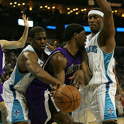 19 November 2008:  New Orleans Hornets guard Chris Paul (3) knocks a ball away from Sacramento Kings forward John Salmons (15) as Hornets forward James Posey (41) defends during a NBA game between the Sacramento Kings and the New Orleans Hornets at at the New Orleans Arena in New Orleans, LA..