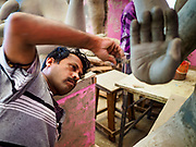 08 SETEMBER 2018 - BANGKOK, THAILAND:  A craftsman finishes the clay work on a Ganesh statue at Wat Witsanu Hindu Temple, also called the Vishnu Temple, in Bangkok. Indian craftsmen are making statues of the Hindu deity Ganesha for the Ganesh Chaturthi, or Ganesh Festival, held at Hindu temples in September. All of the craftsmen, and the clay they use to fashion the statues, come from India every year to make the statues. Although Thais are predominantly Buddhist, the Lord Ganesh, the Hindu overcomer of obstacles, is worshipped by many Thais and Ganesh Chaturthi is celebrated in many Thai communities.        PHOTO BY JACK KURTZ