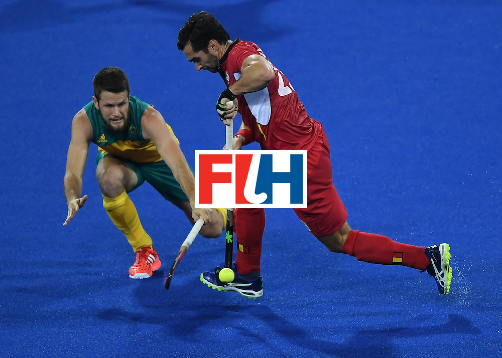 Australia's Matt Gohdes (L) vies for the ball with Belgium's Loick Luypaert during the men's field hockey Belgium vs Australia match of the Rio 2016 Olympics Games at the Olympic Hockey Centre in Rio de Janeiro on August, 9 2016. / AFP / MANAN VATSYAYANA        (Photo credit should read MANAN VATSYAYANA/AFP/Getty Images)