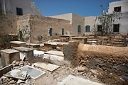 Broken tombstones are seen in the cemetery behind the Rabbi Ekiazer Synagogue on the island of Djerba on May 27,2016. Vandals  did not break the gravestones but the graves were  exhumed and sent to Israel for reburial . (Photo by Heidi Levine).
