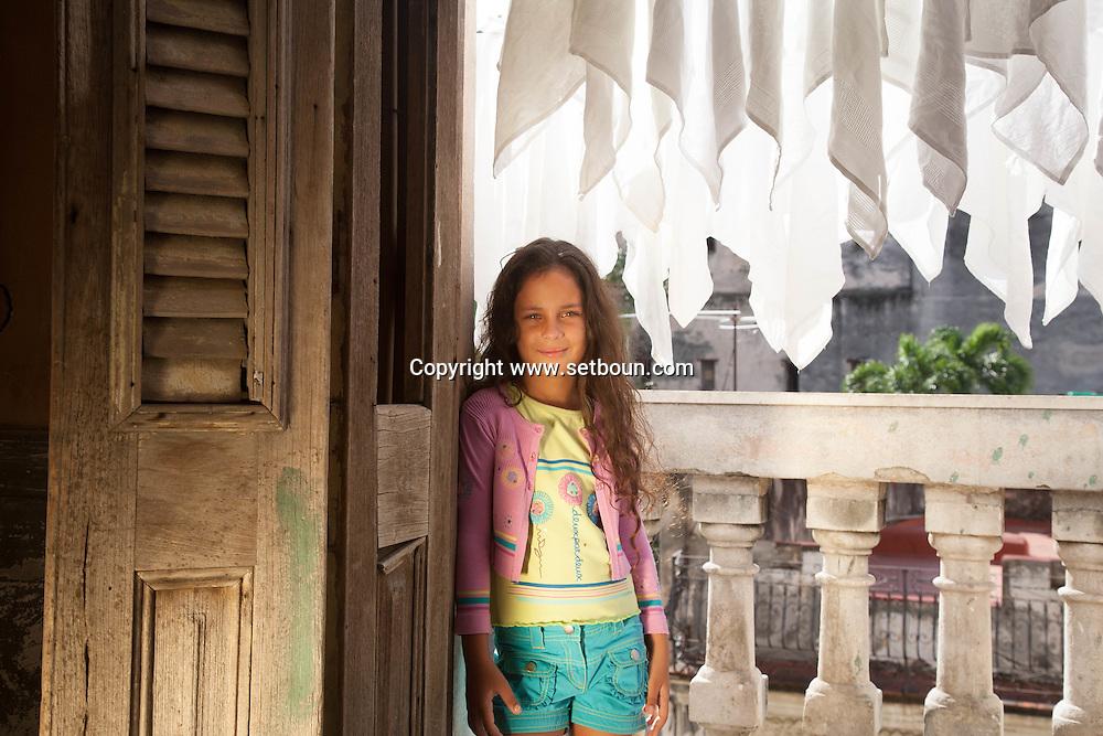 CUBA: Havana. children's fashion for little girls. In a   old decaying house.  the place of the movie, fresa y chocolate. Havana CITY center.  centro Habana.      / Cuba. La Havane.  mode enfantine pour petite filles. dans une  vielle maison bourgeoise et baroque delabree. ou a ete tourne le film fraise et chocolat. La Havane centro,    calle concordia 418 ,