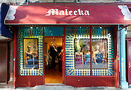 Maleeka Woman's Dress and Jewelry Lifestyle boutique, with customers and seen inside open door, evening of Atlantic Avenue Artwalkk, on Atlantic Avenue, Beorum Hill, Brooklyn, New York, USA, night of June 6, 2009