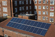 Solar photo voltaic (PV) panels on the roof of Hackney council estate Bannister House, the first community solar installation on a estate in Hackney, London United Kingdom.  Bannister House was Hackney's first community solar installation, Banister House Solar, has been developed by Re-powering London in partnership with local estate residents and Hackney Council, and delivered using funds raised through a community share offer. The 102kWp solar array generates up to 82,000kWh of energy annually, saving 50,000kg of CO2 emissions. In addition, a portion of the revenue generated through the government's Feed-in Tariff and sale of energy over the 20-year life of the project will generate over £28,000 for the Banister House Solar community fund. Hackney, London. (photo by Andrew Aitchison / In pictures via Getty Images)