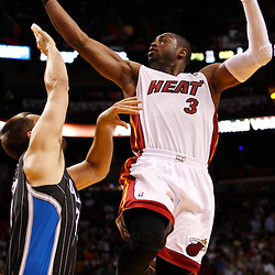 March 3, 2011; Miami, FL, USA; Miami Heat shooting guard Dwyane Wade (3) shoots over Orlando Magic power forward Ryan Anderson (33) during the fourth quarter at the American Airlines Arena. The Magic defeated the Heat 99-96.    Mandatory Credit: Derick E. Hingle