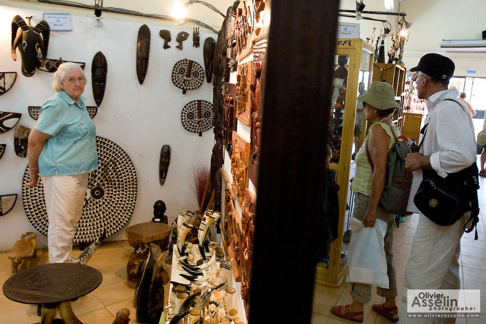 Customers browse in the main shop of the Village Artisanal de Ouagadougou, a cooperative that employs dozens of artisans who work in different mediums, in Ouagadougou, Burkina Faso, on Monday November 3, 2008.
