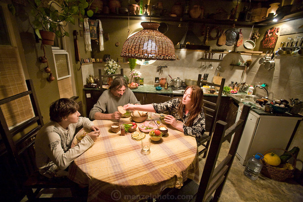 Art restorer Vyacheslav Grankovskiy at the kitchen table with his family at their home in Schlisselburg, outside St. Petersburg, Russia. (Vyacheslav Grankovskiy is featured in the book What I Eat: Around the World in 80 Diets.) MODEL RELEASED.