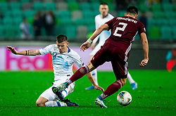 Roman Bezjak  of Slovenia vs Vitalijs Maksimenko  of Latvia during the 2020 UEFA European Championships group G qualifying match between Slovenia and Latvia at SRC Stozice on November 19, 2019 in Ljubljana, Slovenia. Photo by Vid Ponikvar / Sportida