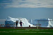 This new field was build in 2017 in Qeqertarsuaq, Disko Island for the national football championship. I was lucky to witness a few games back then. The icebergs in the background definitely made the experience quite surreal.