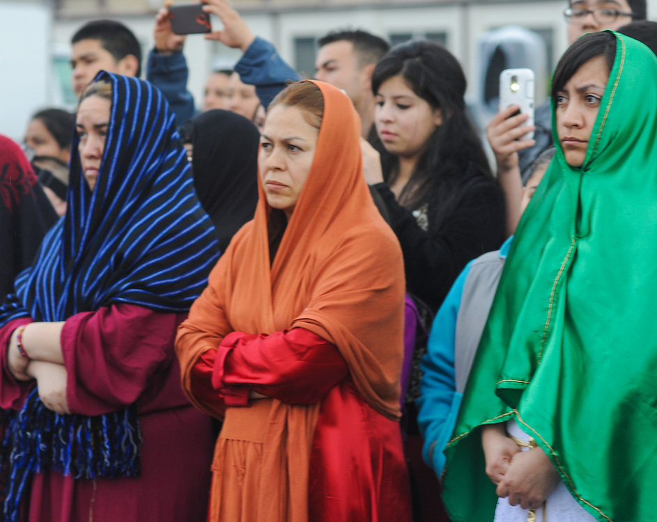 Women watch as Jesus is crucified on Good Friday April 3, 2015 at Our Lady of Fatima in Bensalem, Pennsylvania.  (Photo by William Thomas Cain/Cain Images)