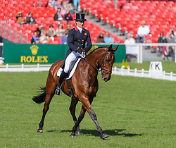 Kristina Cook and DE NOVO NEWS - The Dressage phase of the Mitsubishi Motors Badminton Horse Trials, Friday May 3rd 2013, UK. Photo by: Nico Morgan / i-Images