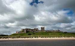 © Licensed to London News Pictures. 02/07/2016. Bamburgh, UK.  Joggers run in the morning sunshine on the beach near Bamburgh Castle, Northumberland.  Photo credit: Anna Gowthorpe/LNP