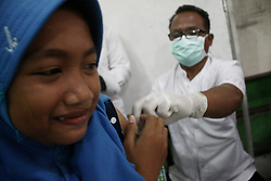 January 3, 2018 - Cibitung Subdistrict, West Java, Indonesia - Medical Officer conducted Outbreak Response Immunization (ORI), by giving immunization of DPT (Diphtheria, Pertussis, Tetanus) to students at Wanasari 14 State Elementary School, Wanasari Village, Bekasi Regency, West Java Province, on the second day of school after long holiday. (Credit Image: © Aditya Irawan/NurPhoto via ZUMA Press)