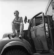 Men sitting in and on a truck, Glastonbury, Somerset, 1989